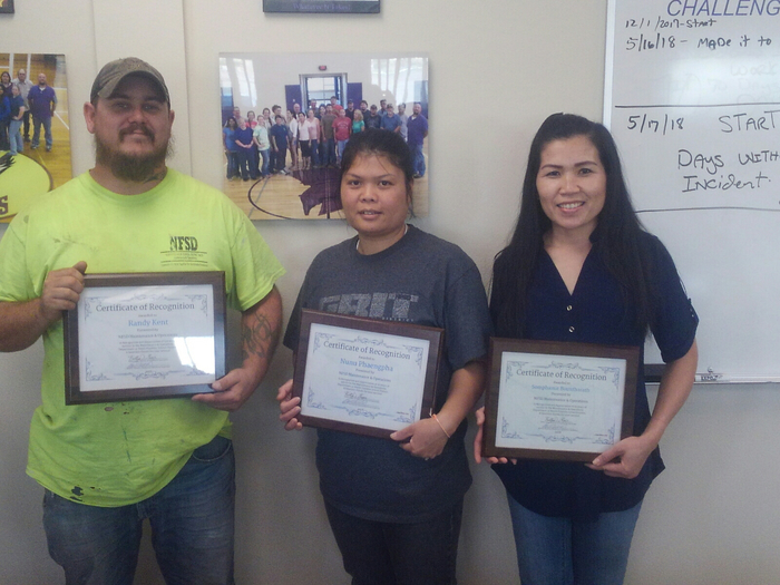 Randy, Nunu, and Somphamit receive recognition awards